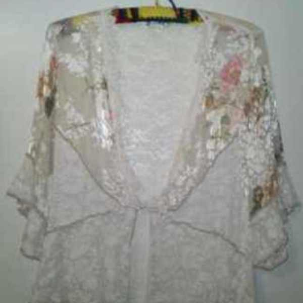BEAUTIFUL SHEER FLORAL LACE TOP is being swapped online for free