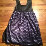 Fancy children's lace and purple and black dress is being swapped online for free