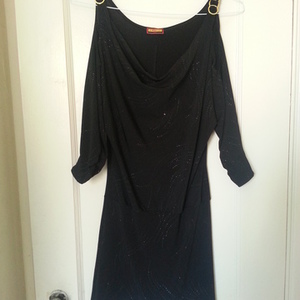 Black dress with gold accents M is being swapped online for free