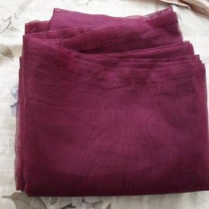 Shiny-ish purple sheer Ikea curtains is being swapped online for free
