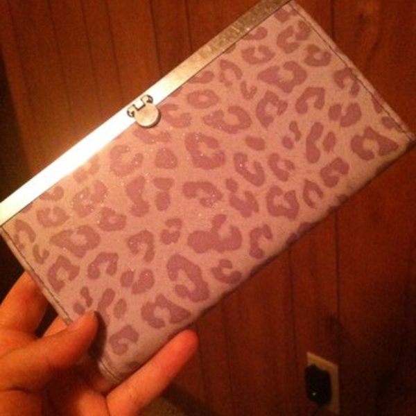 Purple Leopard Print Wallet   is being swapped online for free