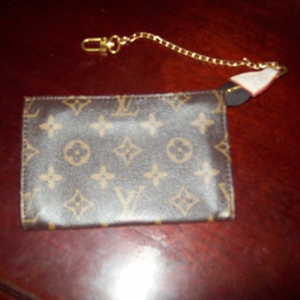 LV coin purse. is being swapped online for free