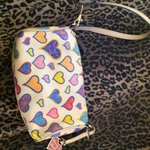 Authentic dooney and Bourke wristlet/purse is being swapped online for free