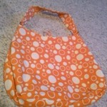 Cute summery reversable orange purse is being swapped online for free