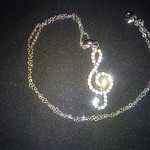 treble clef necklace is being swapped online for free
