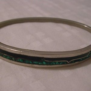 Green / Black / Silver Bracelet is being swapped online for free
