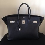 Hermes Birkin 35 Black with Silver Hardware is being swapped online for free