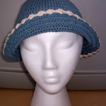 Blue & Cream Knit Bonnet Hat  is being swapped online for free