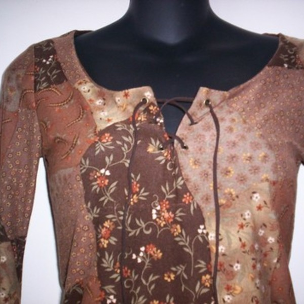 Brown Flowery Top Medium  is being swapped online for free