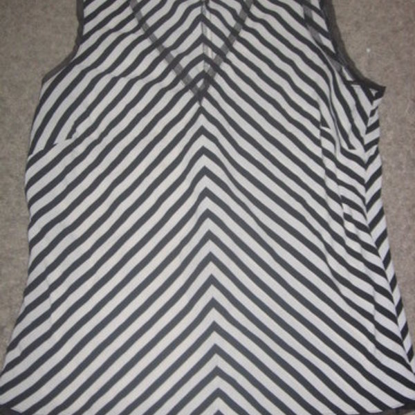 Old Navy Black & White Striped Top Medium is being swapped online for free