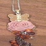 Butterfly charm pendant/ necklace - vintage style. is being swapped online for free