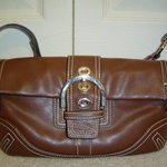 Brown Coach Purse is being swapped online for free
