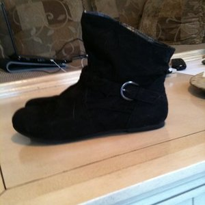 black ankle boots. is being swapped online for free