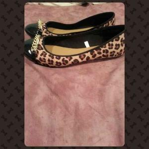 NWOT Cute cheetah flats is being swapped online for free