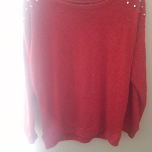 Red Spiked Sweater is being swapped online for free