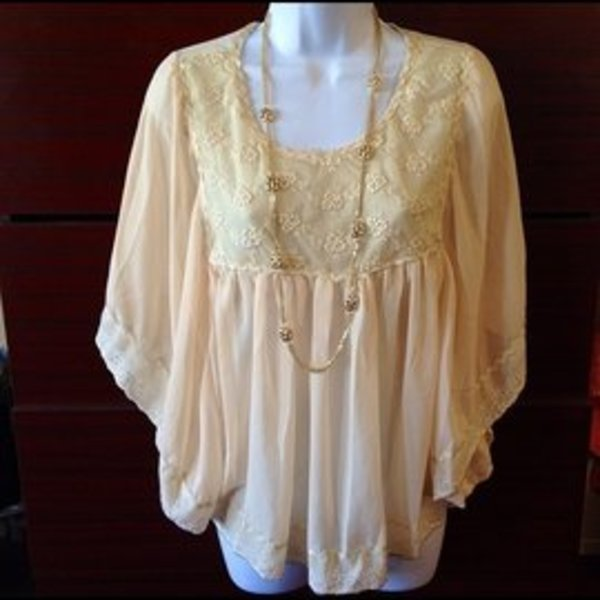 Sans Soucie boho top M is being swapped online for free