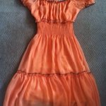 Cute orange dress Sz Sm is being swapped online for free