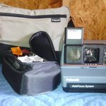 Vintage Polaroid camera with Case and Accessories is being swapped online for free