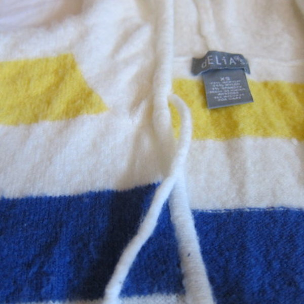 Delias fruit-stripe white sweater XS is being swapped online for free