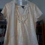 Moda International/Victoria's Secret Gold Embellished Top is being swapped online for free