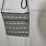 Ethnic shoulder bag in silver gray is being swapped online for free