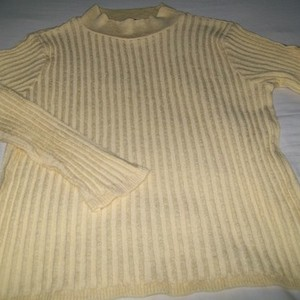 Liz Claiborne Yellow Sweater is being swapped online for free