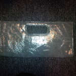 Grey Giannini Faux Leather Clutch Purse  is being swapped online for free