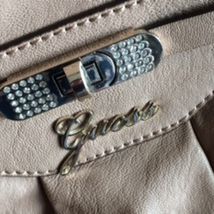 Beige Guess Handbag is being swapped online for free