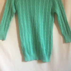 Teal knit sweater  is being swapped online for free