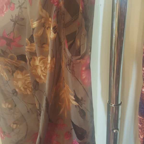 NWT Floral Blouse  is being swapped online for free