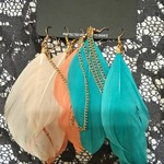 Orange Turquoise White Feather Earrings is being swapped online for free
