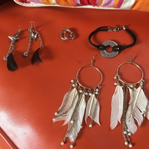 Boho feather jewelry!!One Pair Is Sterling!!! is being swapped online for free