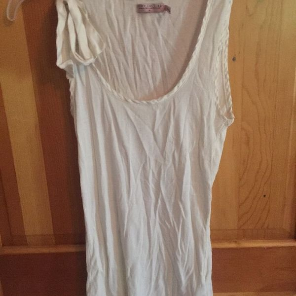 Juicy Couture White Tank Size Medium is being swapped online for free