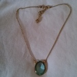 Green glass and gold necklace is being swapped online for free