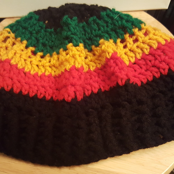 Never Worn Knitted Rasta Beanie  is being swapped online for free