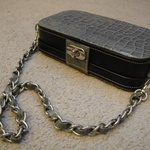 Dark Grey, Black, and  Metal  Chain purse is being swapped online for free