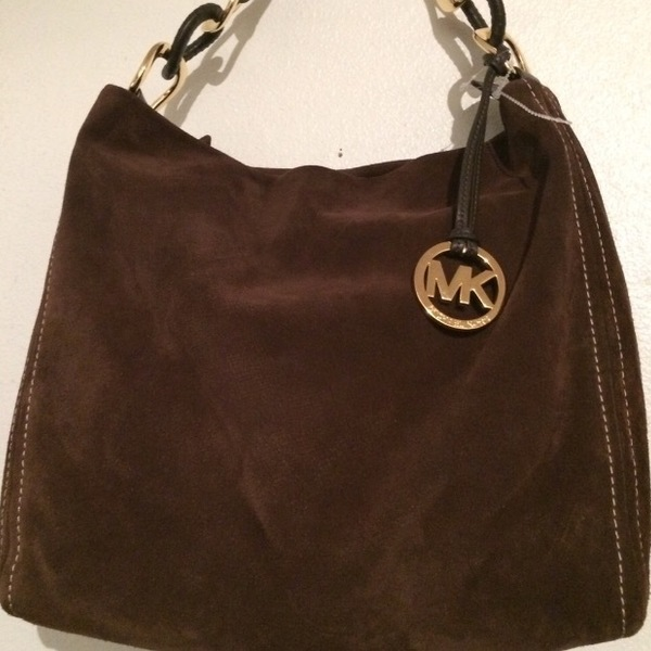 Micheal Kors brown suede purse  is being swapped online for free