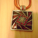 Red Square Pendant on multiple string necklace is being swapped online for free