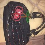 BETSEY JOHNSON BETSEYVILLE BLACK DENIM RUFFLED CHERRIES SATCHEL BAG is being swapped online for free