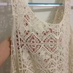 Cream crochet/lace top with fringe. (Fits a bit bigger than a small) is being swapped online for free