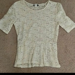 Ivory Lacy Peplum 3/4 Sleeve Top is being swapped online for free