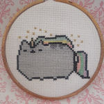 Pusheen Unicorn Cross stitch in gold glitter hoop is being swapped online for free