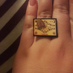 Mini Ouija board ring with planchette is being swapped online for free