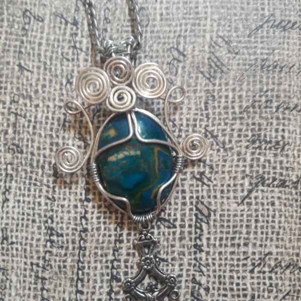 Beautiful wire wrapped blue stone necklace with chain is being swapped online for free