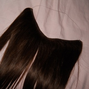 Brand New ! Flexy Halo Hair extensions in Chocolate brown 20 inches ( Human Hair ) is being swapped online for free