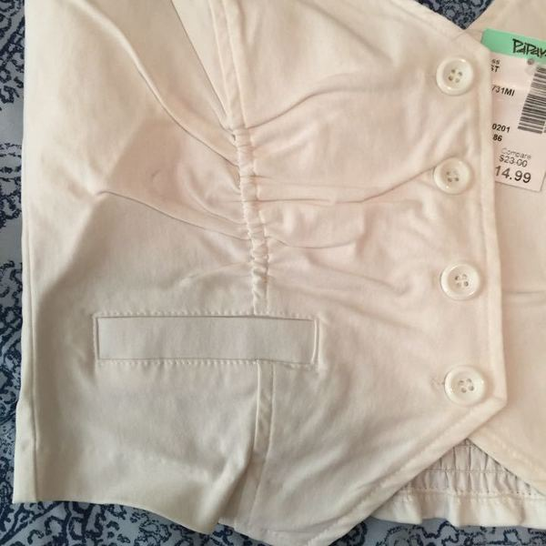 Brand New White Vest Size Small is being swapped online for free