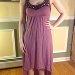 Purple high low dress with lace detail and criss-cross back is being swapped online for free
