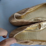 Coach Ariza Beige Gold Logo Flats is being swapped online for free
