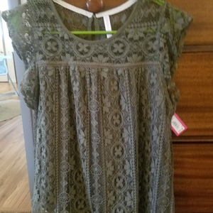 Green lacy new with tags shirt. Size medium. Xhilaration brand is being swapped online for free