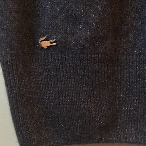 Lacoste figure showing sweater dress is being swapped online for free